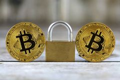 Physical version of Bitcoin new virtual money and golden padlock. Stock Images