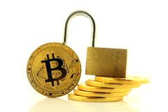 Physical version of Bitcoin new virtual money and golden padlock. Royalty Free Stock Photography