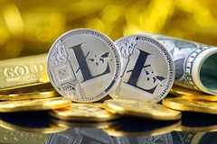 Physical version of Litecoin new virtual money and banknotes of one dollar. Royalty Free Stock Photography