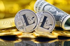 Physical version of Litecoin new virtual money and banknotes of one dollar. Royalty Free Stock Image