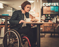 Physically challenged women in a cafe. Physically challenged woman in a cafe Stock Images