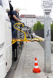 Physically disabled bus accessibility platform. Vienna, Austria - May 1, 2015: A bus assistant is preparing accessibility platform for physically disabled person Stock Photos