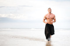 Physically fit man running Stock Images