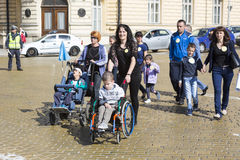Physically and mentally disabled people. Sofia, Bulgaria - April 6, 2016: Physically and mentally disabled are accompanied by their parents, relatives and Stock Images