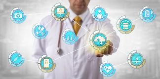 Physician Activates Mobile Cloud Data Transfer. Unrecognizable physician activating cloud computing data transfer in mobile network. Health care and information stock image