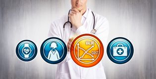 Free Physician Analyzing Value Vs Cost Of Telemedicine Royalty Free Stock Photography - 157318727