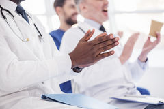 Physician applauding at conference in hospital Stock Photography