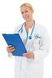 Physician with blue clipboard Royalty Free Stock Image