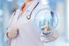 Physician clicks on the icon of a human lung. Concept design stock image