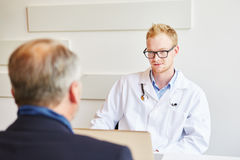 Physician in consultation. With patient giving advice Stock Image
