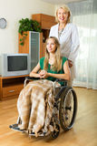 Physician and disabled girl communicating Stock Image