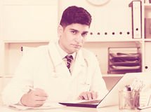 Physician is doing report about patients Stock Image