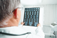 Physician examines MRI image Stock Photos