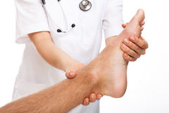 Physician examining painful foot Royalty Free Stock Photography
