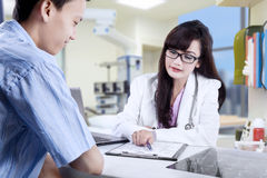 Physician explaining checkup result Stock Images