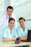 Physician and female nurses Stock Photography