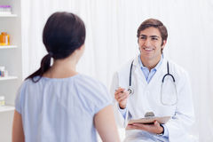 Physician having good news for patient Royalty Free Stock Images