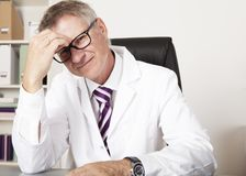 Physician Having Headache Stock Photography