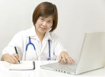 Physician at her desk royalty free stock photography