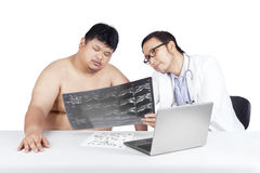 Physician and his patient looking at x-ray Royalty Free Stock Photo