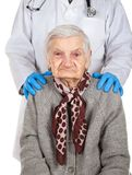 Assisted living. Physician holding elderly disabled woman`s shoulders - Assisted living stock images