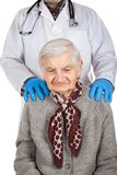 Assisted living. Physician holding elderly disabled woman`s shoulders - Assisted living royalty free stock photos