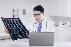 Physician with laptop and x-ray image Stock Photo