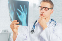 Physician looks at x-ray image Royalty Free Stock Image