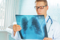 Physician looks at x-ray picture Royalty Free Stock Images