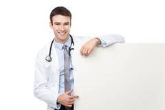 Physician pointing at banner Royalty Free Stock Images