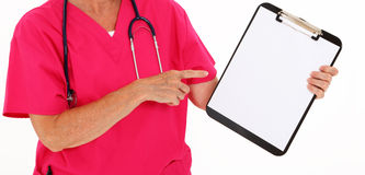 Physician Pointing At Clipboard. Over White Background Stock Photos