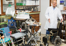 Physician posing near orthopaedic equipment Stock Images