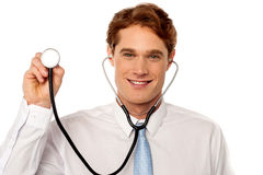 Physician posing withstethoscope Royalty Free Stock Photos