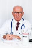 Physician in practice with stethoscope and laptop. Stock Photo