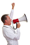 Physician protesting with megaphone. Senior physician protesting with clenched fist and a megaphone Stock Photo