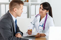 Physician ready to examine patient and help Stock Photography