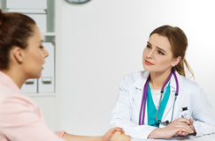 Physician ready to examine patient and help Stock Photo