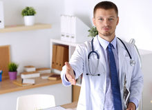 Physician ready to examine patient Stock Photo