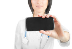 Physician showing phone screen Royalty Free Stock Photos