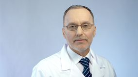 Physician smiling, posing for camera, professionalism and qualified medical care. Stock photo Royalty Free Stock Photo