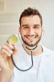 Physician with stethoscope. Smiling friendly Royalty Free Stock Photo