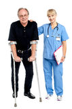 Physician supporting her courageous patient. Helping him walk Stock Images
