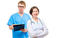 Physician and surgeon companions portrait. On white background Royalty Free Stock Photos