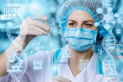 Physician takes a sample for the medical test . stock photos