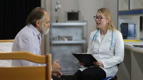 Physician telling good medical results to patient stock footage