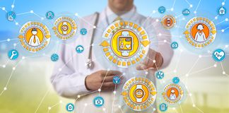 Physician Tracking Pulse Trace Of Remote Worker. Unrecognizable male physician is tracking the pulse trace of a remote worker via smart watch. Healthcare concept royalty free stock images