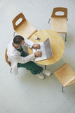 Physician Using Laptop In Cafeteria Royalty Free Stock Photography