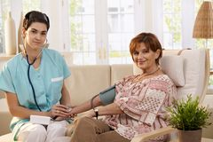 Physician using stethoscope Stock Image
