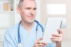 Physician using tablet pc Stock Photos