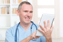 Physician using tablet pc Stock Photography